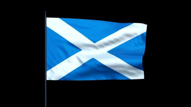 The Scottish flag waves against a black background.