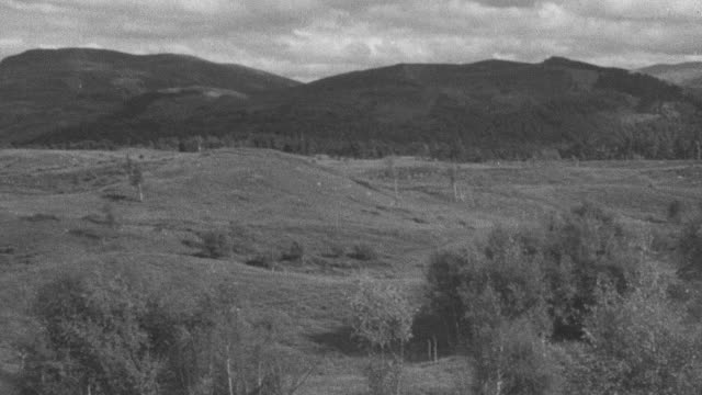 1944 pan the scottish highlands and moors / achriesgill, scotland, united kingdom - achriesgill stock videos and b-roll footage
