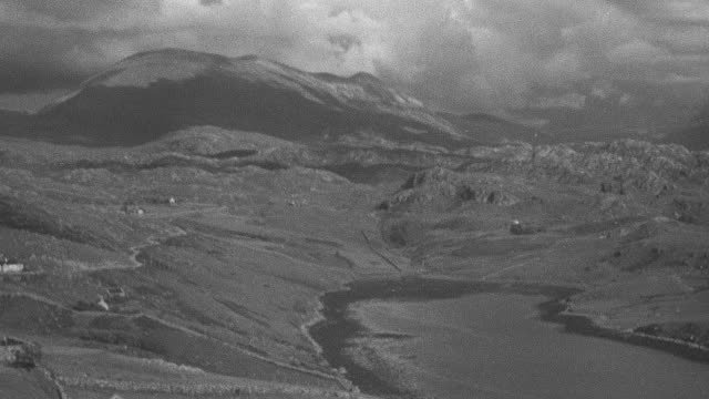1944 pan the scottish highlands and moors with mountains behind / achriesgill, scotland, united kingdom - achriesgill stock videos & royalty-free footage