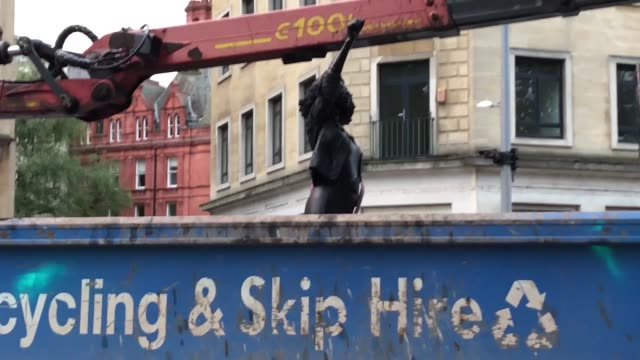stockvideo's en b-roll-footage met the sculpture of a black lives matter protester which replaced the statue of slave trader edward colston has been removed. pictures from the scene... - verschijning