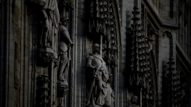 The sculptures on the facade of the town hall in Brussels.