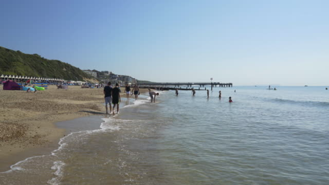the sea and shore at boscombe beach, bournemouth, uk - bournemouth england stock videos & royalty-free footage