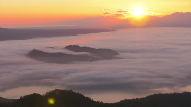 the sea of clouds over lake kussharo - light natural phenomenon stock videos & royalty-free footage