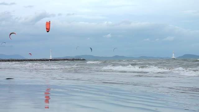 the sea with kitesurfing on sky. - kite sailing stock videos and b-roll footage