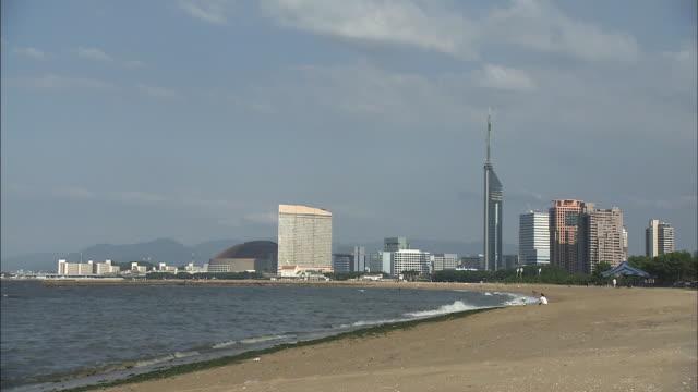 "the seaside area on the west side of fukuoka includes landmarks such as momochi seaside park fukuoka yafuoku dome –the home stadium of the ""fukuoka... - ウォーターフロント点の映像素材/bロール"