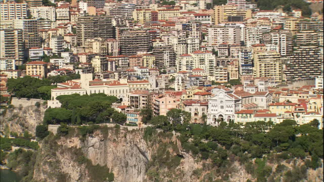 the seaside town of monaco boasts the oceanographic museum at the base of mountains in the french riviera. - monaco stock videos and b-roll footage