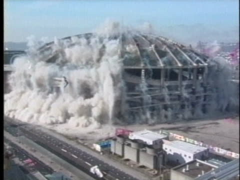 the seattle kingdome implodes in a cloud of dust in a time-lapse capture of its demolition. - luogo d'interesse locale video stock e b–roll