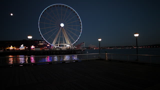 The Seattle Waterfront at night during the summer season.
