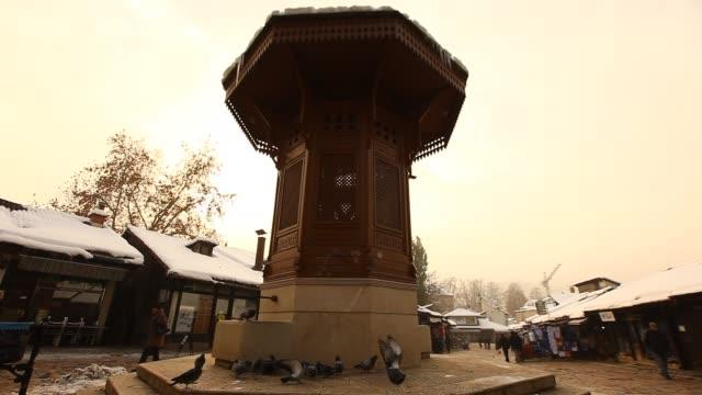 The Sebilj fountain in Sarajevo with pigeons