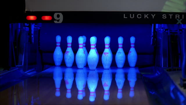 the second roll of a bowling frame downs all ten pins for a hard spare. - ボーリングボール点の映像素材/bロール