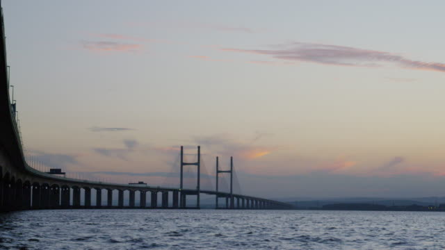 the second severn crossing bridge, at sunset. - haltbarkeit stock-videos und b-roll-filmmaterial