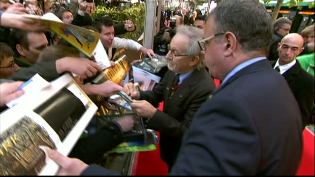 'TINTIN The Secret Of The Unicorn World' Premiere at Le Grand Rex Shows exterior shots of Film Director Steven Spielberg signing autographs on the...