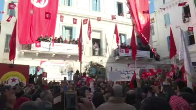 The secretary general of Tunisia's powerful UGTT trade union Noureddine Taboubi gives a speech in front of a crowd gathered in front of the union's...