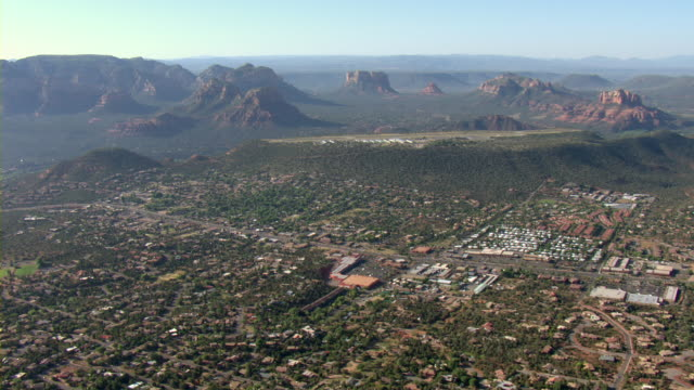 the sedona airport towers, from a plateau, above sedona residences. - sedona stock videos & royalty-free footage