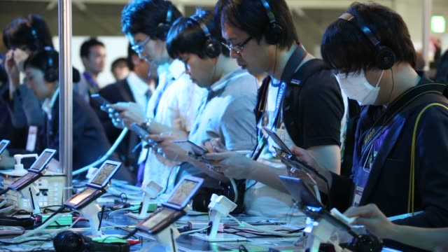 the sega corp. booth is seen at the tokyo game show 2014 in chiba, japan, attendees play video games on nintendo co. 3ds handheld gaming consoles in... - television game show stock videos & royalty-free footage