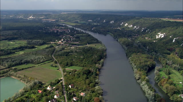 the seine near moisson  - aerial view - île-de-france, yvelines, arrondissement de mantes-la-jolie, france - river seine stock videos & royalty-free footage