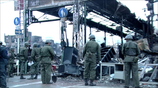 the selfdefense forces personnel and police officers search damage in the aftermath of the 1995 hanshin earthquake near kobe japan - japan self defense forces stock videos and b-roll footage