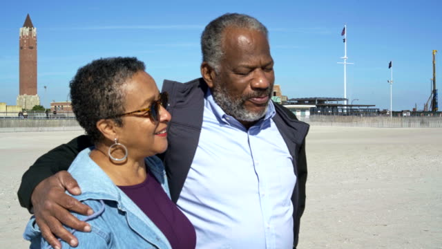 The senior African-American couple walking at the Jones Beach