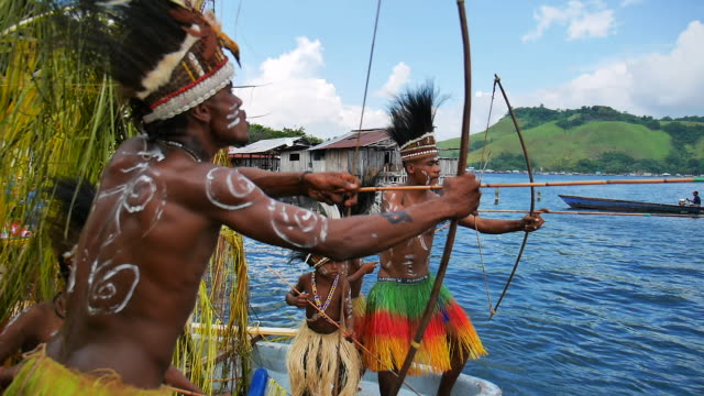 the sentani lake festival is one of three impressive festivals on papua besides the baliem valley festival and the asmat festival that together offer... - grashütte stock-videos und b-roll-filmmaterial