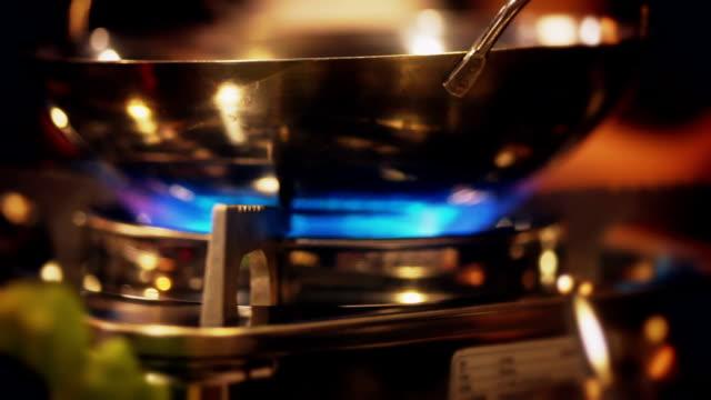 The shabu-shabu pot on a gas stove.