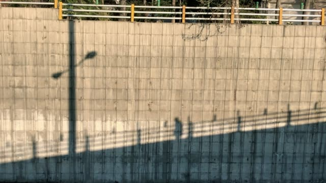 the shadow of a man walking across the bridge - tehran stock videos & royalty-free footage