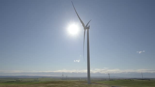 the shadow of a spinning wind turbine is seen near a gate as other wind turbines stand at the hornsdale wind farm operated by neoen sas near... - jamestown stock-videos und b-roll-filmmaterial