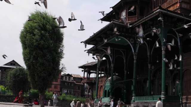 The Shah Hamdan Masjid or Shah-I-Hamdan Mosque, the medieval mosque considered an architectural marvel with pigeons flying in Srinagar, Kashmir valley