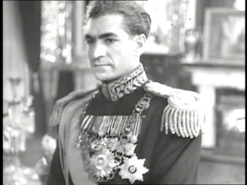 vidéos et rushes de the shah of iran mohammed reza pahlavi poses in uniform - 1953