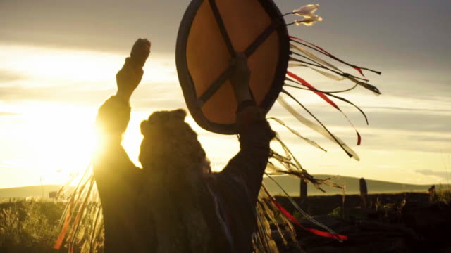 the shaman performs the rite at sunrise. - ceremony stock videos & royalty-free footage