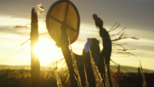 the shaman performs the rite at sunrise. - traditional ceremony stock videos & royalty-free footage