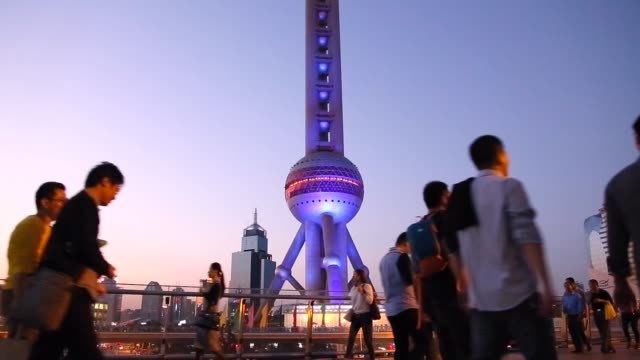 the shanghai cityscape at night in the pudong business district with people hang out and gathering under the main iconic landmark the oriental pearl... - main tower stock-videos und b-roll-filmmaterial