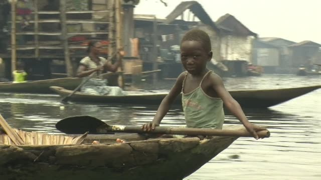 the shanty town of makoko built partly on water in lagos is growing day by day like other areas of nigeria's commercial capital it is struggling to... - other stock videos & royalty-free footage