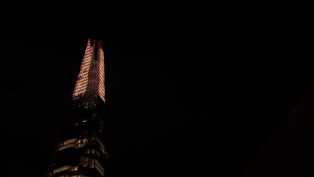 the shard and london bridge general views england london the shard lit up at night / buses along london bridge - shard london bridge stock videos & royalty-free footage