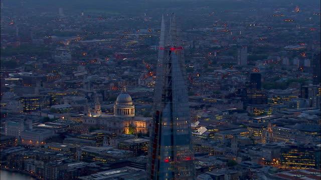 the shard dominates the twinkling london skyline. - shard london bridge stock videos & royalty-free footage