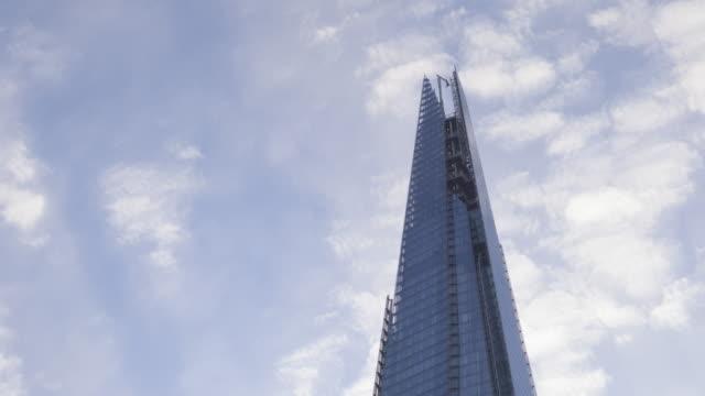 the shard rising above the city of london, england. - shard london bridge stock videos & royalty-free footage