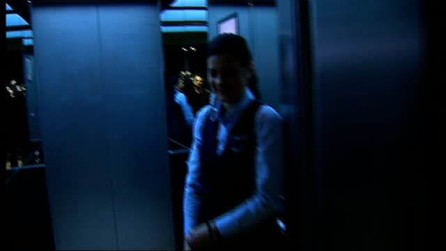 vídeos de stock, filmes e b-roll de general views / boris johnson cutting ribbon tracking shot along and into lift / people standing in lift as it ascends / tracking shot out of lift... - cortando fita