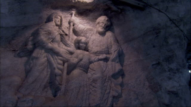 the sheer edge of a salt mine features a bas relief carving of the holy family. available in hd. - carving craft product stock videos & royalty-free footage