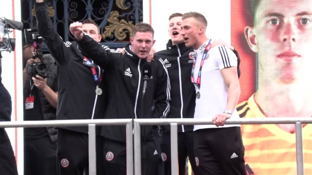 stockvideo's en b-roll-footage met the sheffield united team celebrate their promotion to the premier league in the city centre with captain billy sharp and manager chris wilder... - sheffield