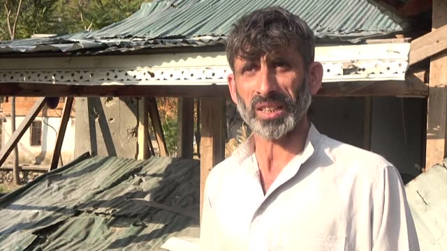 the shells and bullets are hurtling even thicker and faster than normal over kashmir's ceasefire line, scarring for life villagers like zameer ahmad... - border stock videos & royalty-free footage