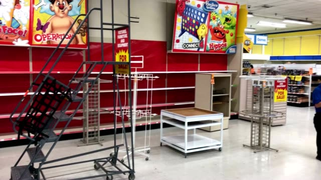 The shelves are nearly empty at this Toys R Us in California as it is a few days away from closing its doors forever