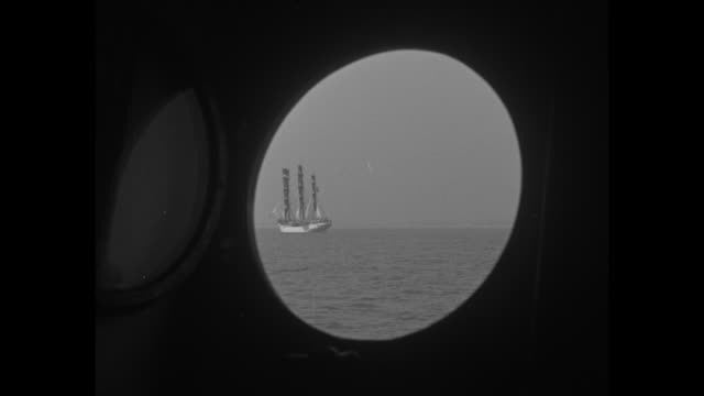 the ship sorlandet manned by merchant marines in full sail on lake michigan / view of sorlandet through porthole of another ship / view of sorlandet... - chicago world's fair stock videos & royalty-free footage