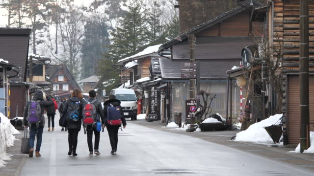 the shirakawago they are famous for their traditional gasshozukuri farmhouses some of which are more than 250 years old - strohdach stock-videos und b-roll-filmmaterial
