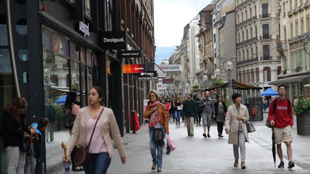 the shopping street rue de la croix d'or in downtown geneva in switzerland passersby can be seen and various shops and brand names - dor stock videos & royalty-free footage