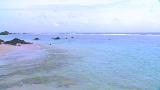 the shoreline of tokunoshima island - south pacific ocean stock-videos und b-roll-filmmaterial
