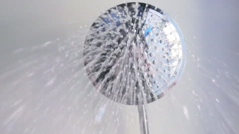 the shower in slow motion: water flows directly to the camera, the bottom view - bathroom stock videos & royalty-free footage