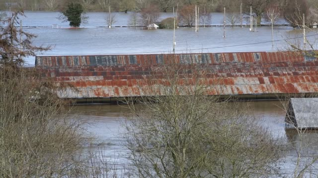 the showground in shrewsbury completely underwater flooded by the river severn after the wettest february ever recorded in the uk - barn stock videos & royalty-free footage