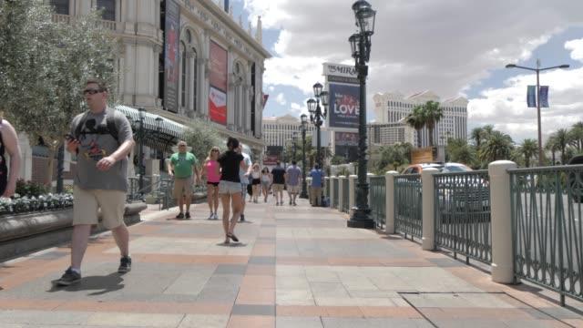the sidewalk near venetian exterior on the strip, las vegas boulevard, las vegas, nevada, united states of america, north america - venetian hotel las vegas stock videos & royalty-free footage