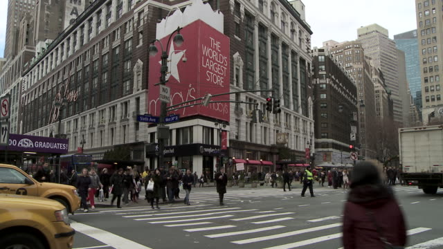 """the sign on 6th and 34th of """"macy's the worlds largest store""""  crowds of shoppers cross 34th street/ - 34th street stock videos and b-roll footage"""