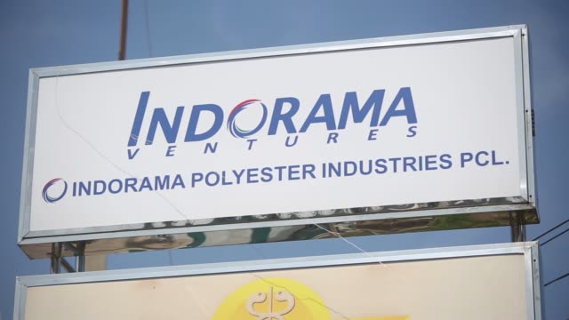 stockvideo's en b-roll-footage met the signage for indorama polyester industries pcl nakhon pathom at the entrance to the polyester production facility operated by ventures pcl in... - polyester