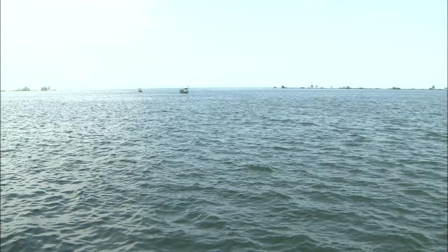 the sihanoukville port: long shot/ pan left. - cambodia stock videos & royalty-free footage